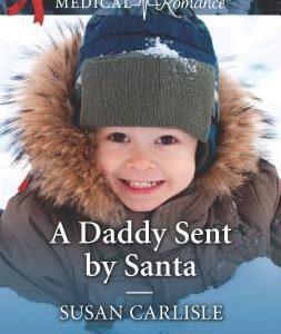 * Review * A DADDY SENT BY SANTA by Susan Carlisle