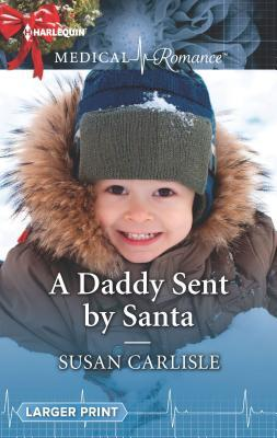 * Review * A DADDY SENT BY SANTA by Susan Carlisle